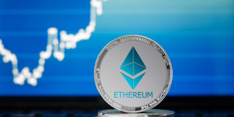 Ethereum blue logo coin in front of Ethereum price prediction chart