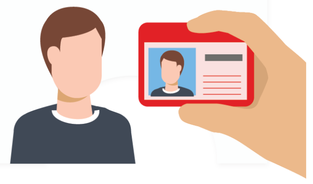 man with Id being held up to his face with white background