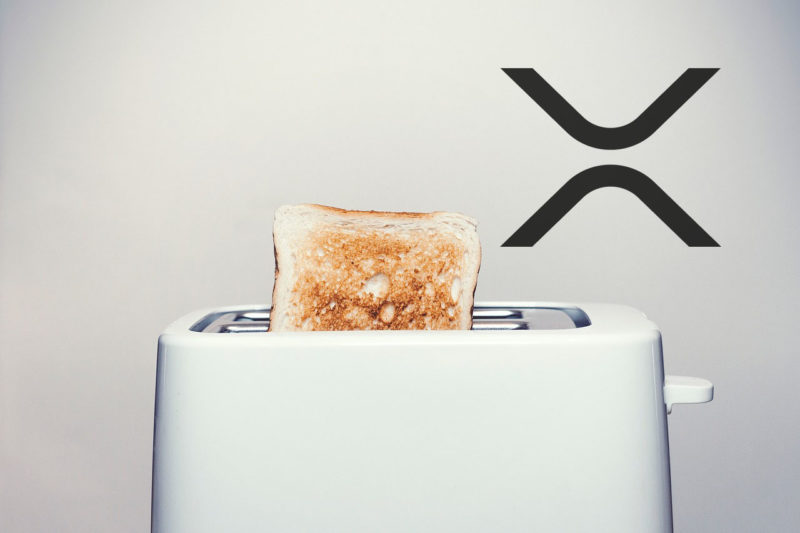 Toast in a white Toaster with XRP logo next to it with white background
