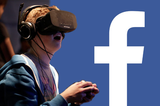 Young man with Facebook VR headset on next to facebook logo
