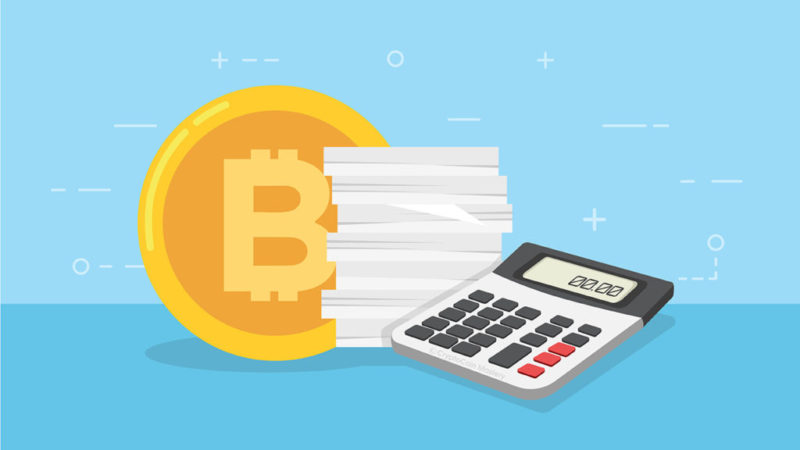 Bitcoin with calculator and blue background to represent Bitcoin and cryptocurrency tax