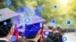 graduating students with blockchain network graphic on top
