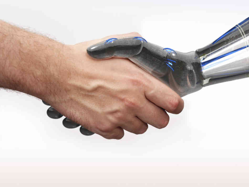 Human and robot arm shaking hands