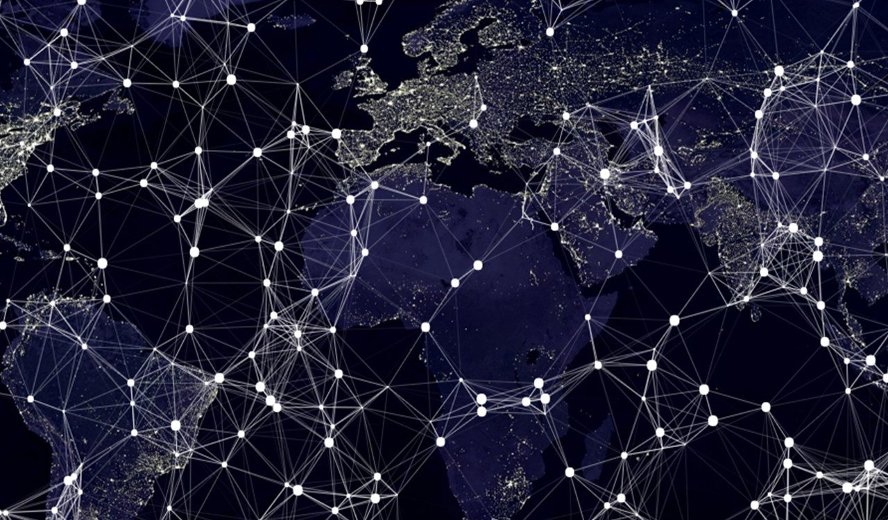 Decentralised network over a world map at night time