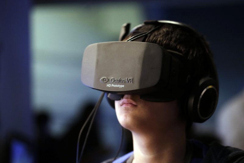 boy with occulus rift vr headset on with out of focus background